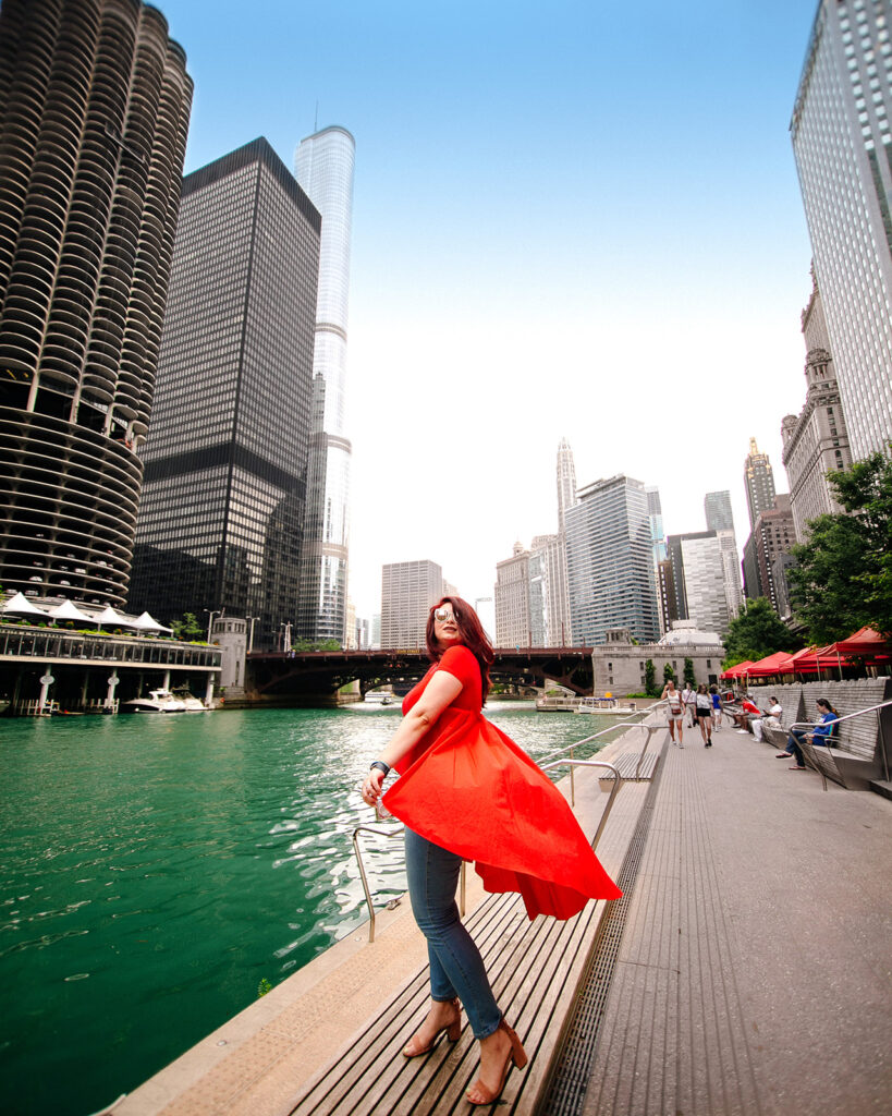 dancing in a red dress by the Chicago riverwalk